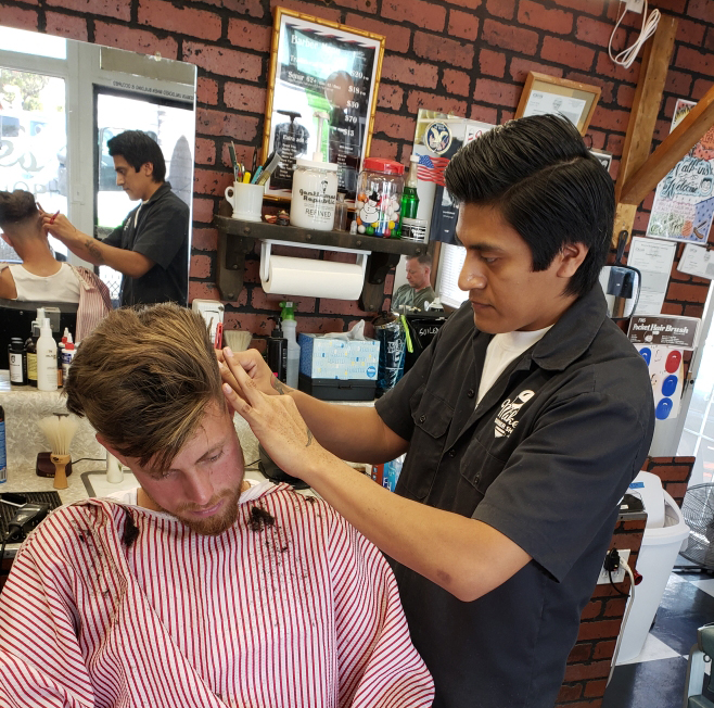 Barber Zee cutting hair at the Pismo barber shop